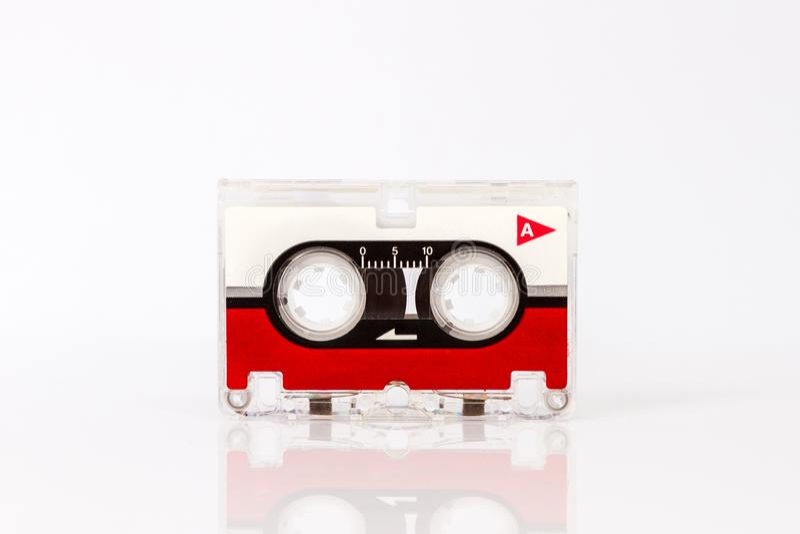 Микро- магнитофонная кассета изолированная на белой предпосылке стоковое изображение
