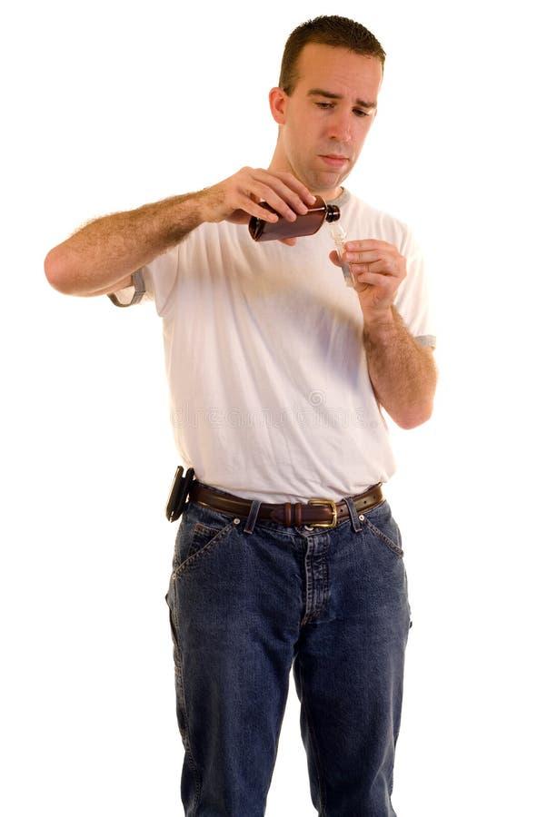 микстура кашлья измеряя стоковая фотография