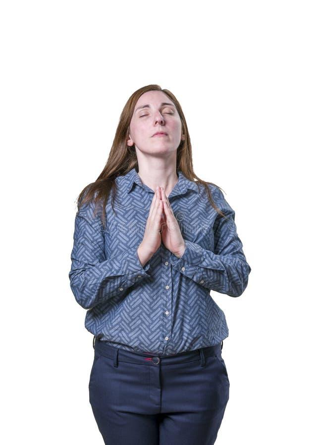 Милая бизнес-леди делая раздумье над белой предпосылкой стоковое изображение rf