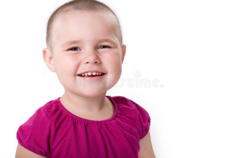 милая девушка смеясь над немного стоковое фото