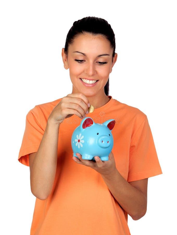 Милая женщина брюнет с piggy-банком стоковое фото rf