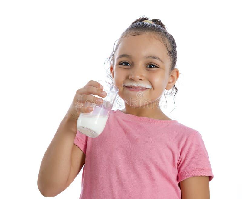 Милая маленькая девочка с усиком молока стоковые фото