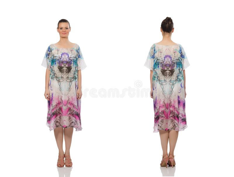 Милая модель в длинном элегантном платье изолированном на белизне стоковое изображение rf
