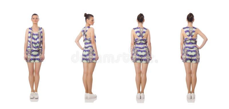 Милая модель нося пурпурное флористическое платье изолированное на белизне стоковые фотографии rf