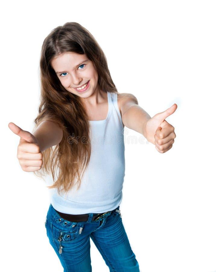 милые большие пальцы руки девушки вверх стоковое изображение rf