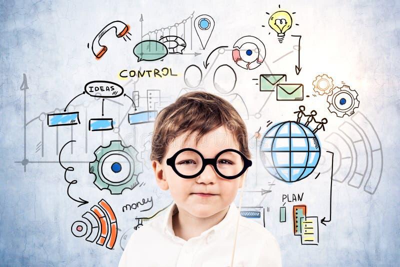 Милые значки управления бизнесмена мальчика стоковое фото