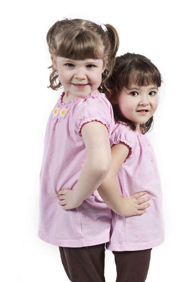 милые сестры 2 детеныша стоковые фотографии rf