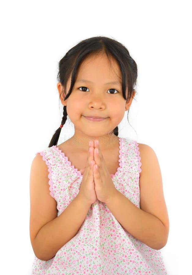Милый азиатский салют получки девушки Таиланда стоковое изображение rf