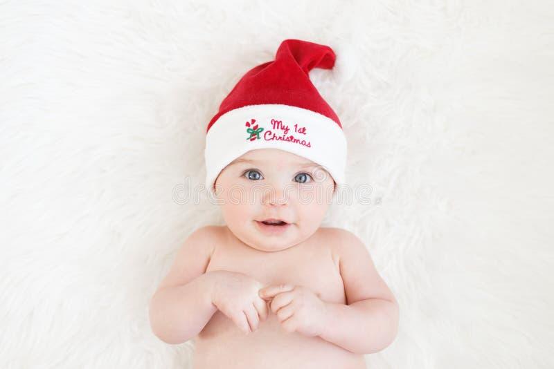 Милый ребенок со шляпой Санта стоковое изображение