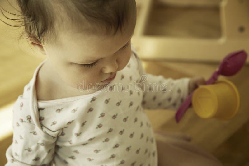 Милый ребенок с игрушками стоковое изображение