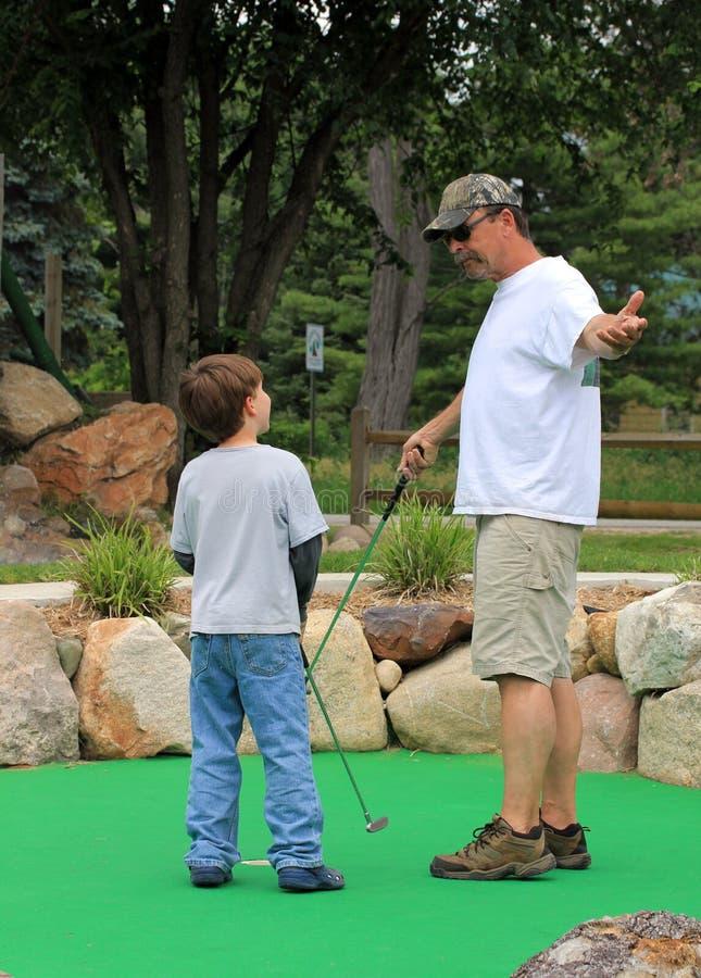 миниатюра гольфа семьи стоковое изображение