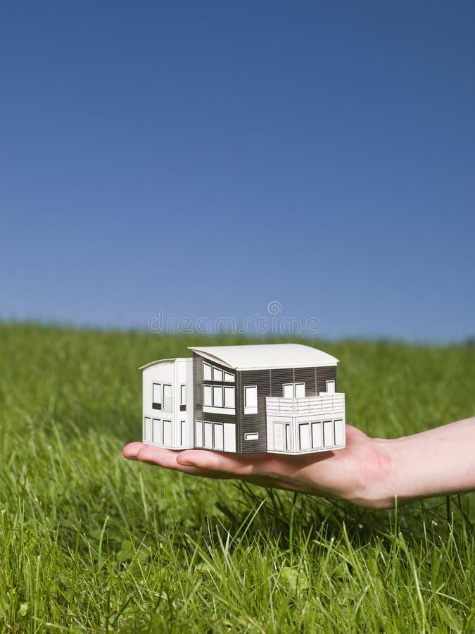 миниатюра дома удерживания стоковое фото rf