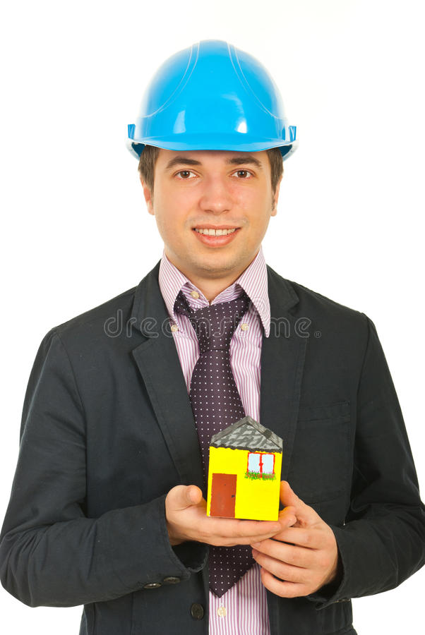 миниатюра человека дома удерживания архитектора стоковое изображение