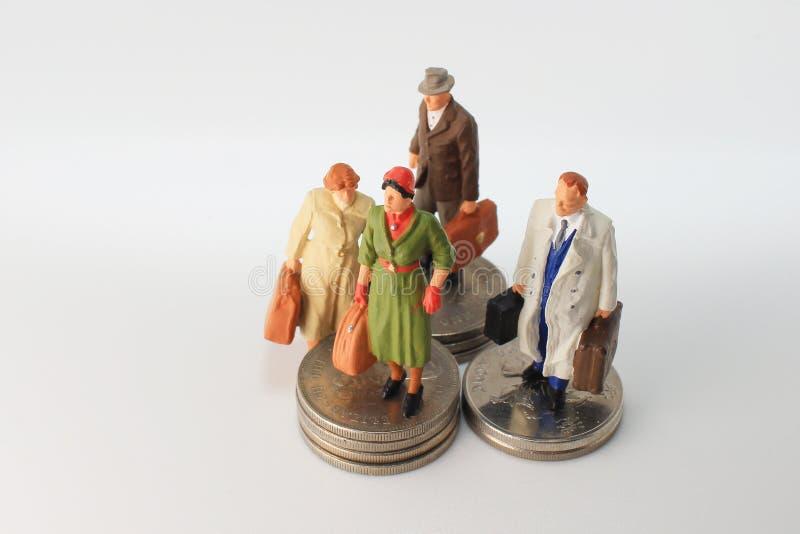 минута диаграммы стойки путешественника на монетках стоковое изображение