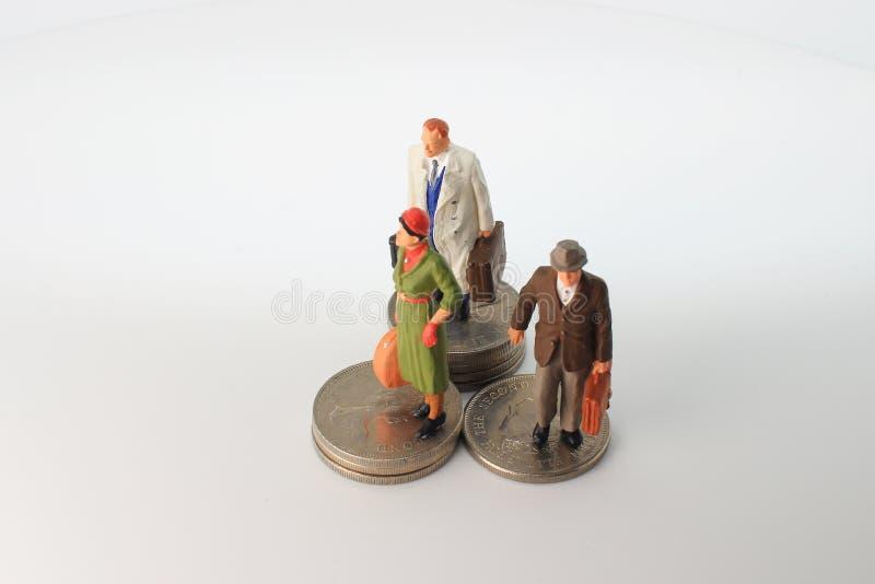 минута диаграммы стойки путешественника на монетках стоковое изображение rf