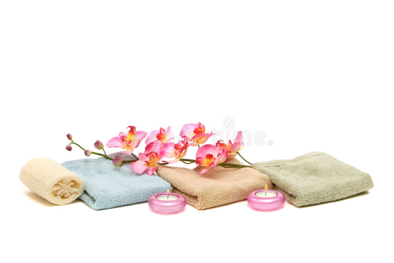 миражирует полотенца спы пинка орхидеи люфы стоковая фотография