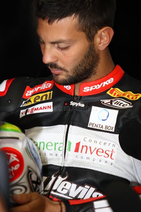 Мишель Fabrizio #84 на Superbike 1000 Roma красных дьяволов фабрики Aprilia RSV4 WSBK стоковые изображения rf