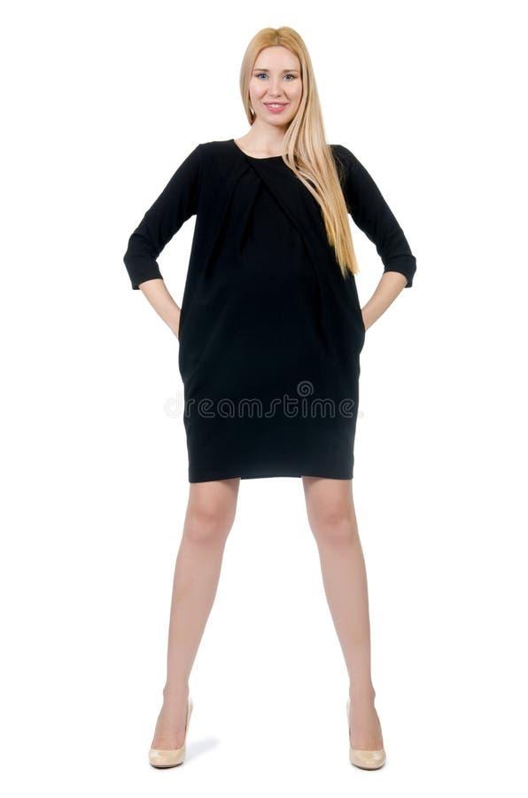 Милая беременная женщина в мини черном изолированном платье стоковые фотографии rf