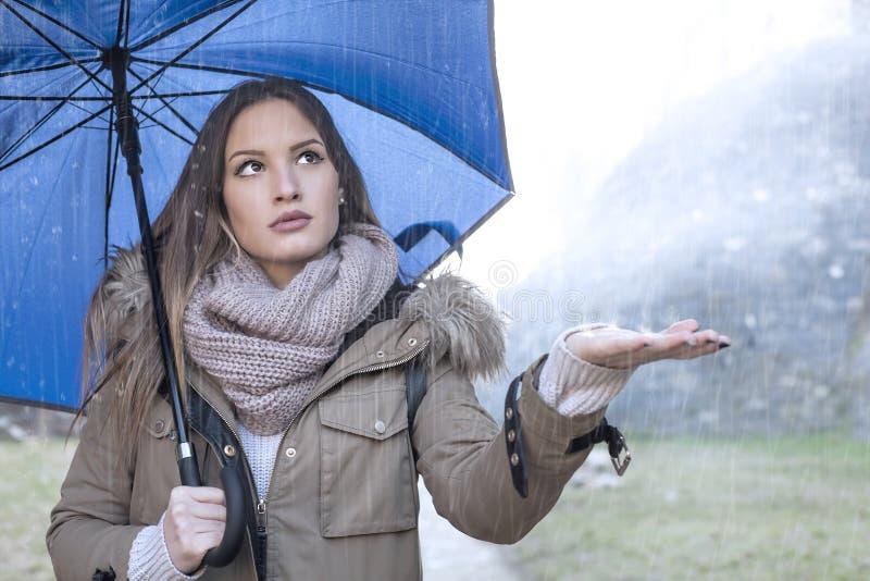 Милая девушка в дожде стоковое фото rf