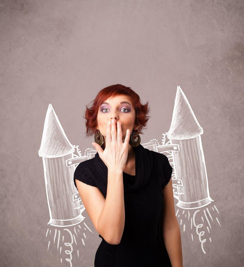 Милая девушка с иллюстрацией чертежа ракеты пакета двигателя стоковые фото