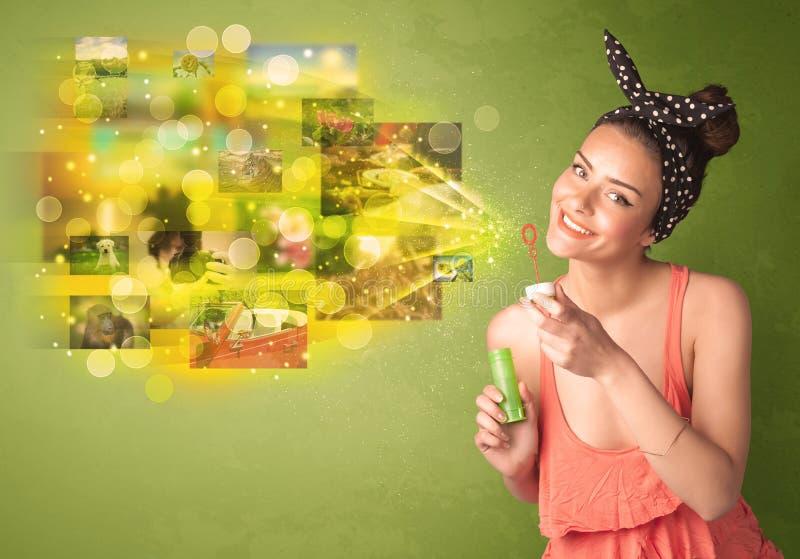 Милая девушка дуя красочная накаляя концепция изображения памяти стоковое фото
