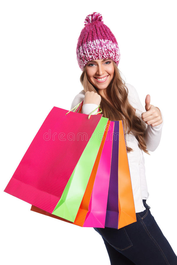 Милая женщина при хозяйственные сумки изолированные на белизне стоковое фото rf