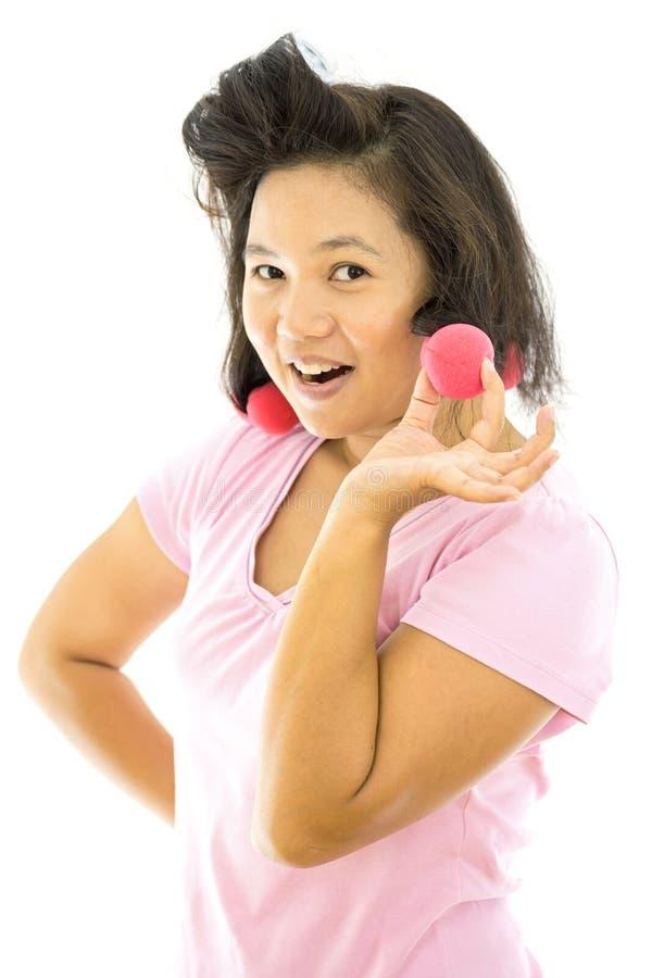 Милая женщина с curlers волос стоковое фото rf