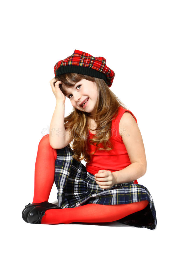 Сидя девушка в красном цвете стоковые изображения rf
