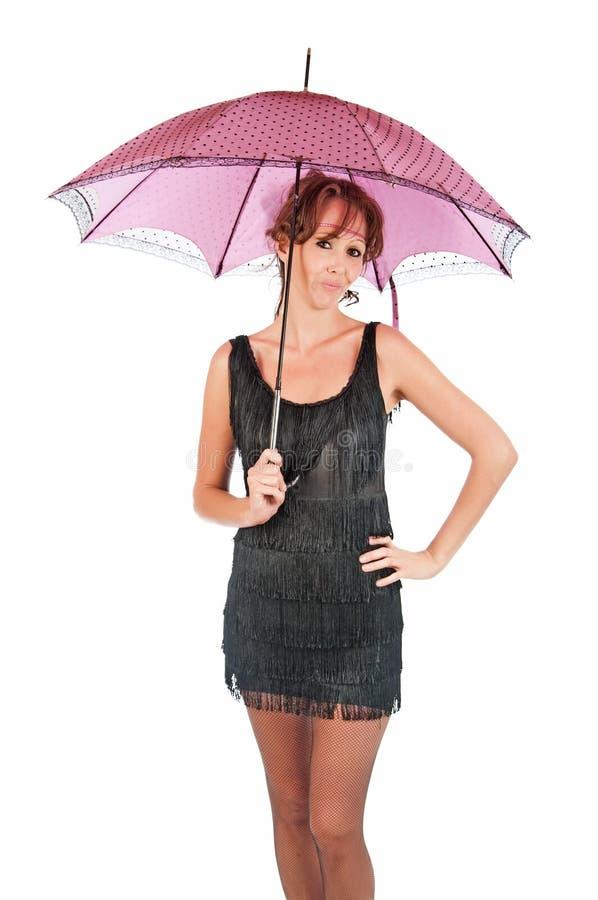 Милая молодая женщина с розовым парасолем стоковая фотография rf
