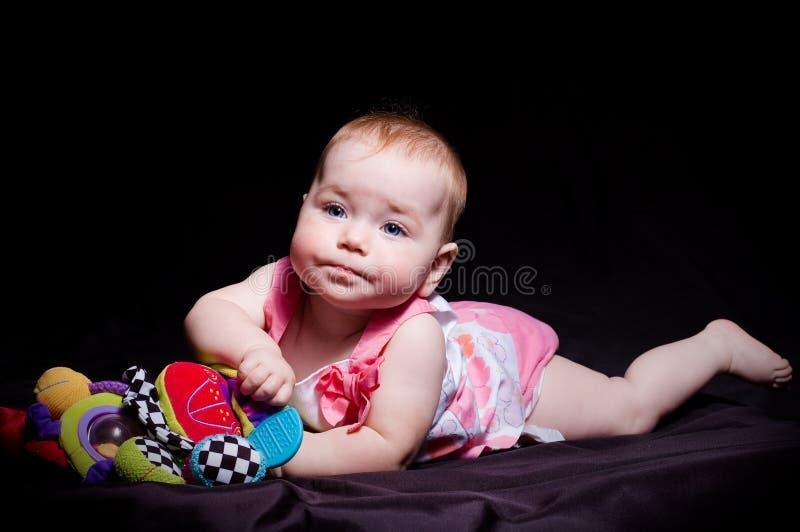 Милые ребёнок и игрушка стоковое изображение rf