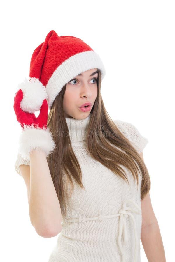 Милый девочка-подросток при шляпа Санты смотря sidewayss стоковая фотография rf