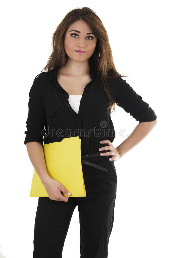 Милый испанский молодой студент держа желтый цвет стоковое изображение