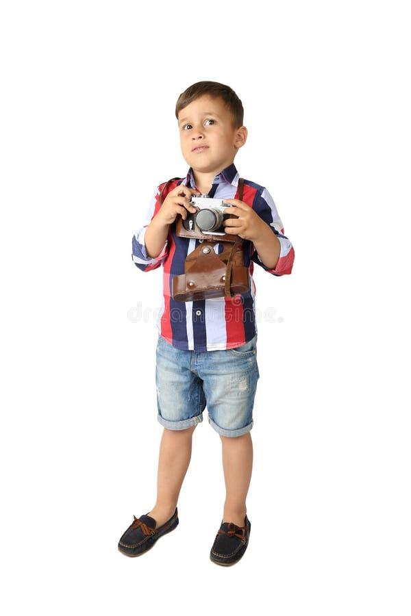 Милый мальчик с винтажной камерой стоковая фотография rf