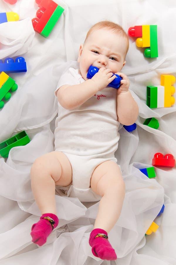 Милый младенец с игрушками стоковое фото
