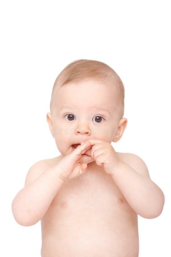 младенец вручает его рот стоковое изображение rf