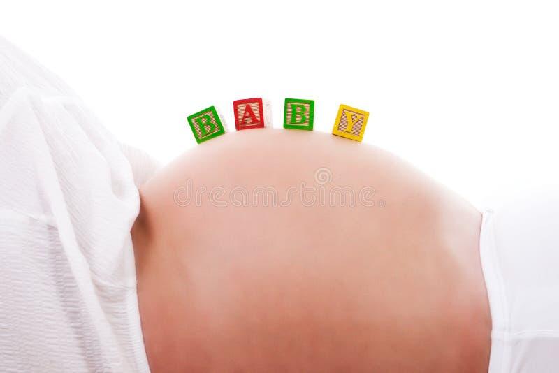 младенец преграждает супоросую женщину живота s стоковое изображение rf