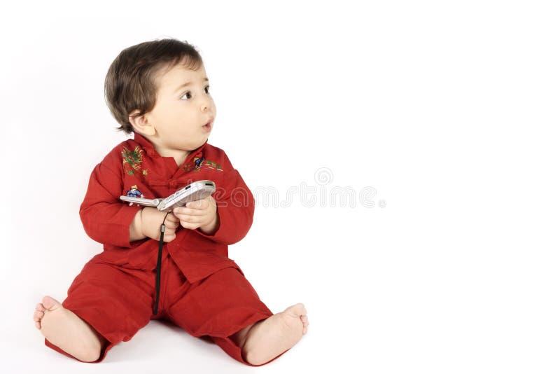 младенец смотрящ сообщение ваше стоковое изображение rf