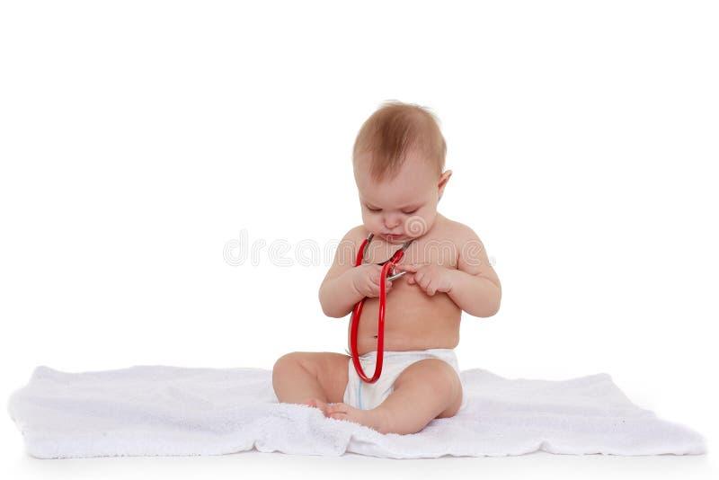 Младенец со стетоскопом стоковое изображение rf