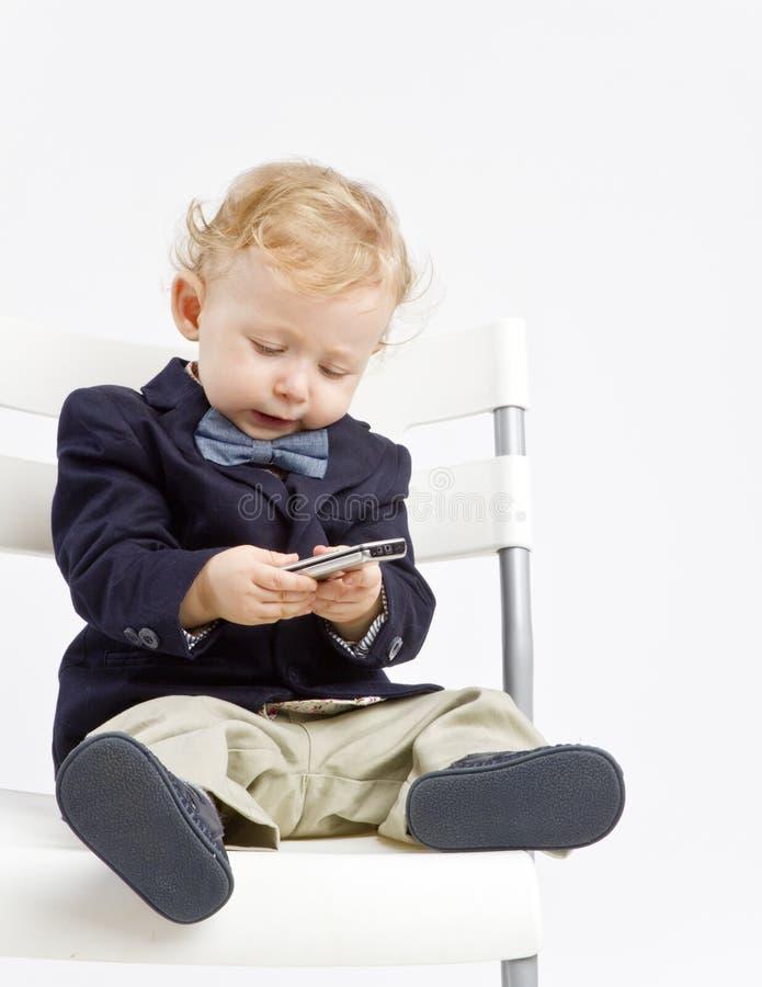 Младенец texting стоковые изображения rf