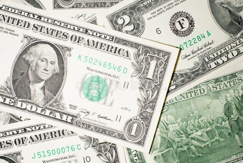 Много банкноты один и 2 доллара США стоковое изображение rf