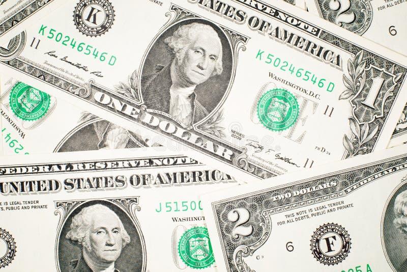 Много банкноты один и 2 доллара США стоковое фото