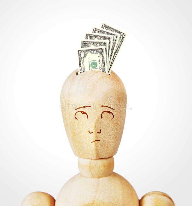 Много банкнот доллара введены в человеческую голову стоковое фото