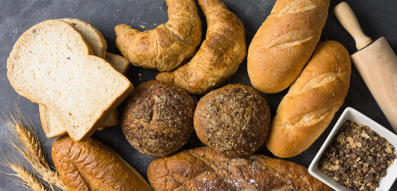 Много видов теста хлеба и свертывать стоковое фото