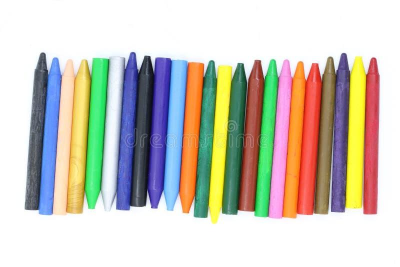 Много покрашенных crayons воска закрывают вверх, вощиют crayons для рисовать, школьные принадлежности, crayons воска для художник стоковые фото