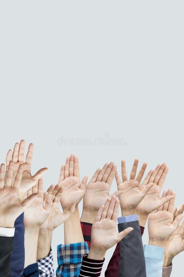 Много рук поднятых совместно стоковое фото rf