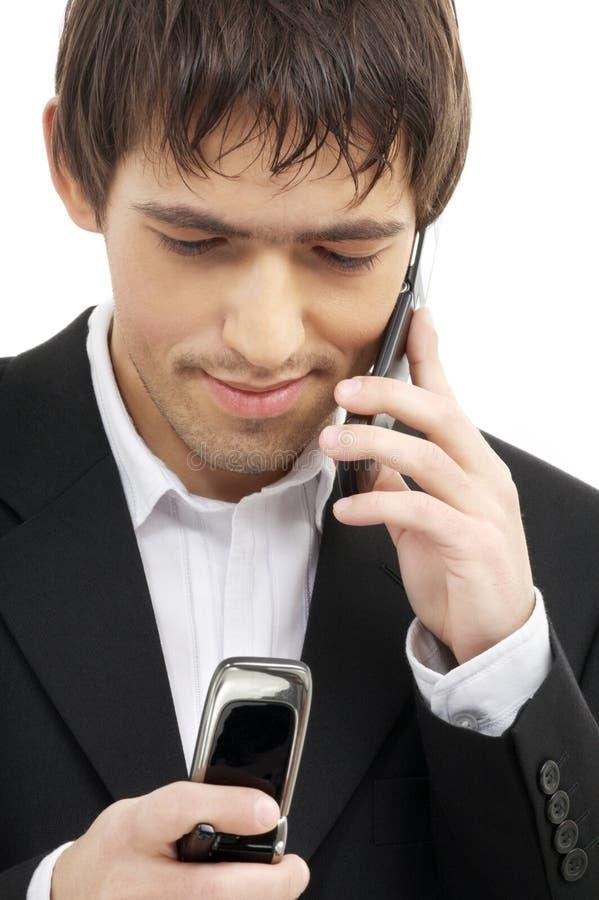мобильные телефоны 2 бизнесмена стоковое фото rf