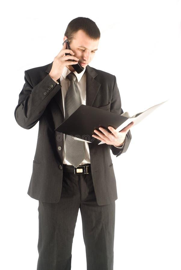 мобильный телефон бизнесмена говоря через стоковое фото rf
