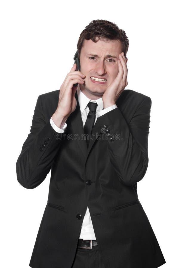 мобильный телефон головной боли бизнесмена стоковое фото rf