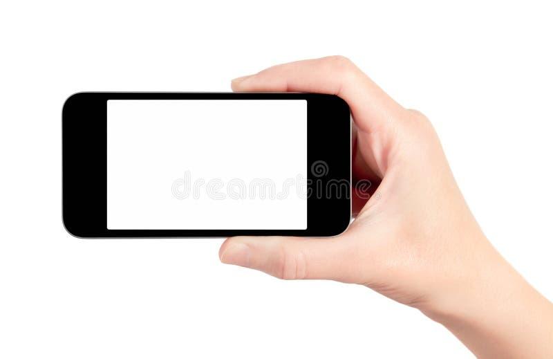 мобильный телефон изолированный рукой франтовской стоковые изображения rf