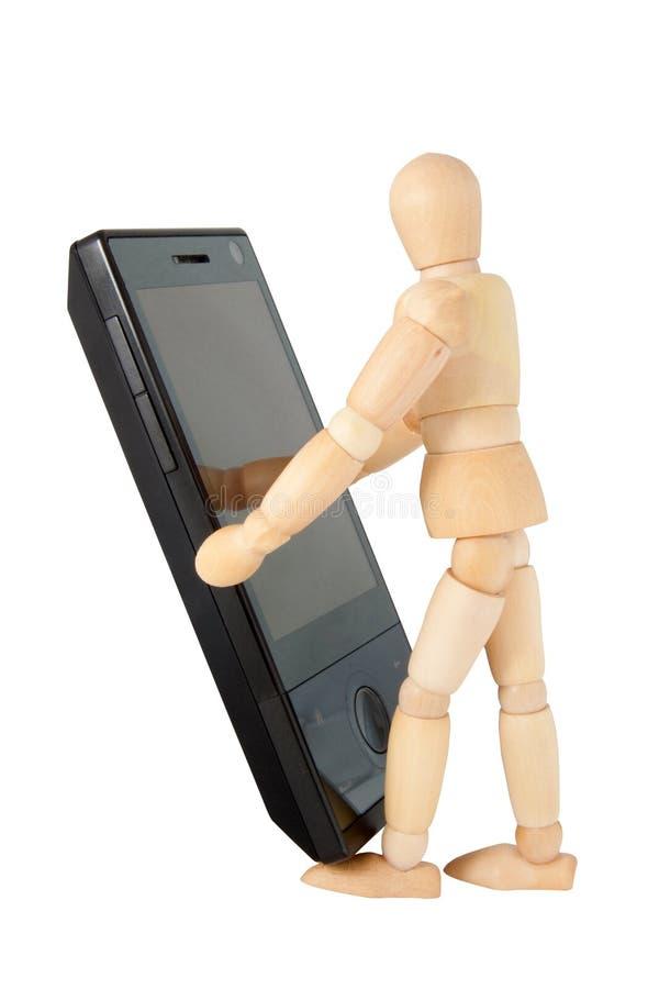 мобильный телефон figurine стоковое фото rf